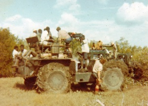swamp tractor and survey crew.